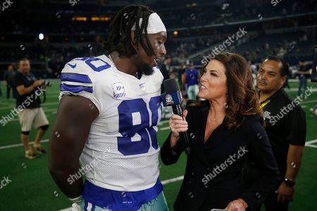 Demarcus Lawrence, Michele Tafoya. Dallas Cowboys defensive end Demarcus Lawrence (90) talks wth field reporter Michele Tafoya with NBC Sports after an NFL football game against the Philadelphia Eagles in Arlington, Texas