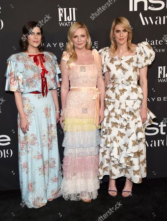 Kirsten Dunst, Laura Mulleavy, Kate Mulleavy. Kirsten Dunst, center, and Rodarte designers Laura Mulleavy, left, and Kate Mulleavy arrive at the 5th annual InStyle Awards, at the Getty Center in Los Angeles