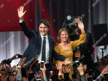 Stock Picture of Canadian Prime Minister and Liberal Party leader Justin Trudeau (L) and wife Sophie Gregoire (R) greet supporters as they celebrate election victory in Montreal, Quebec, Canada, 21 October 2019. Liberal Party leader Justin Trudeau has retained his position as Canadian Prime Minister in the federal election but will be forced to form a minority government.