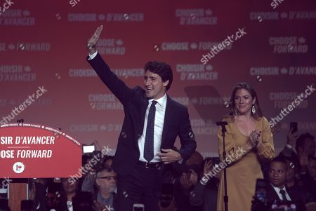 Canadian Prime Minister and Liberal Party leader Justin Trudeau (L) and wife Sophie Gregoire (R) greet supporters as they celebrate election victory in Montreal, Quebec, Canada, 21 October 2019. Liberal Party leader Justin Trudeau has retained his position as Canadian Prime Minister in the federal election but will be forced to form a minority government.