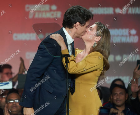 Canadian Prime Minister and Liberal Party leader Justin Trudeau (L) and his wife, Sophie Gregoire Trudeau (R), kiss after a victory speech in Montreal, Quebec, Canada, 22 October 2019. Trudeau has retained his position as Canadian Prime Minister in the federal election but will be forced to form a minority government.