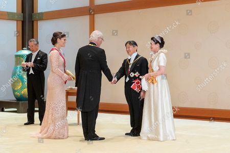 This photo released from the Imperial Household Agency of Japan shows Japan's Emperor Naruhito, second from right, and Empress Masako, right, welcome Sweden's Carl XVI Gustaf, center, and his daughter Crown Princess Victoria, second from left, prior to a court banquet at the Imperial Palace in Tokyo