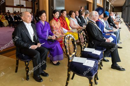 In this photo provided by the Imperial Household Agency of Japan, Swedish King Carl XVI Gustaf, right, and his daughter Crown Princess Victoria attend the enthronement ceremony where Japan's Emperor Naruhito officially proclaims his ascension to the Chrysanthemum Throne, with Cambodia's King Norodom Sihamoni, left, Bhutan's King Jigme Khesar Namgyel Wangchuck, fourth from left, and Queen Jetsun Pema, third from left, at the Imperial Palace in Tokyo