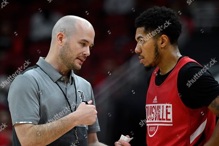 Stock Photo of Louisville assistant coach Luke Murray, left, talks with guard Lamarr Kimble during action of their NCAA college basketball practice in Louisville, Ky