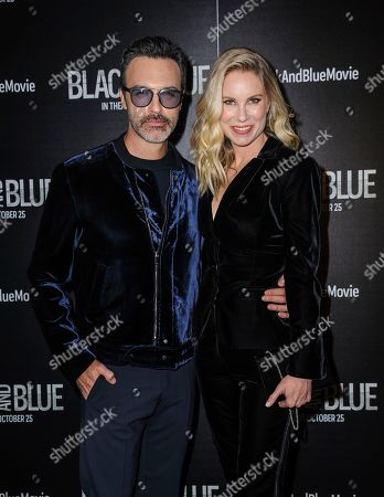 """Reid Scott, left, and Elspeth Keller Scott attend the special screening of """"Black and Blue,"""" hosted by Screen Gems and The Cinema Society, at the Regal E-Walk, in New York"""