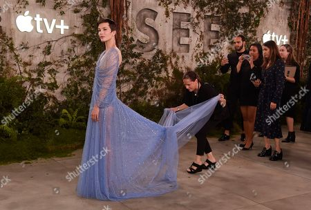 """Sylvia Hoeks, a cast member in the Apple TV+ series """"See,"""" poses while her dress is adjusted at the premiere at the Regency Village Theatre, in Los Angeles"""