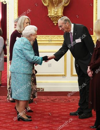 Stock Photo of Queen Elizabeth II meeting Colin Murray-Parkes OBE, aged 91, the Cruse Bereavement Care charity's longest-serving volunteer during a reception to mark the 60th anniversary of Cruse Bereavement Care at St James's Palace in London.