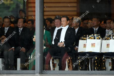Taro Aso, Japan's deputy prime minister and finance minister, front row right, attends the enthronement ceremony at the Imperial Palace in Tokyo, Japan, 22 October 2019. Japan will stage an elaborate ceremony with sacred treasures and host a series of banquets for global royalty and political leaders to mark the enthronement of Emperor Naruhito in the world?s oldest hereditary monarchy.   Some 2,000 guests from Japan and dignitaries from over 180 countries are expected to attend the enthronement ceremony.