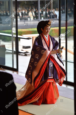 Japan's Crown Princess Kiko leaves at the end of the enthronement ceremony where Emperor Naruhito officially proclaimed his ascension to the Chrysanthemum Throne at the Imperial Palace in Tokyo, Japan, 22 October 2019.