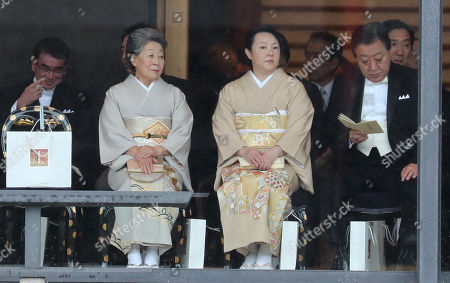 (L-R) Minister for Defence Taro Kono, guest, Hitomi Noda and former PM of Japan Yoshihiko Noda attend the Enthronement Ceremony of Emperor Naruhito at the Imperial Palace
