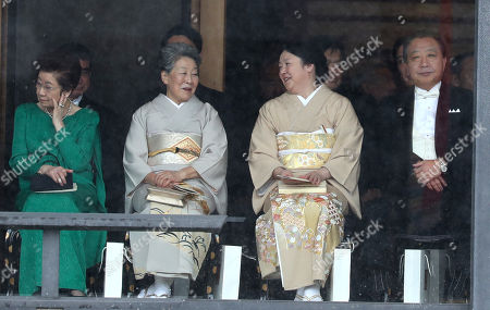 Hitomi Noda (second right) and former PM of Japan Yoshihiko Noda (R) attend the Enthronement Ceremony of Emperor Naruhito at the Imperial Palace