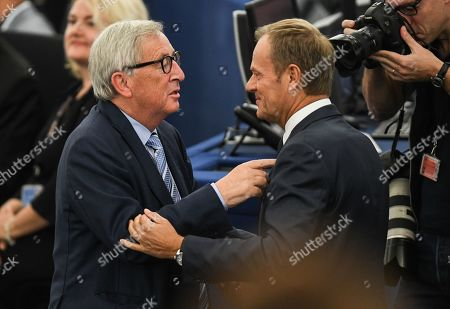 Stock Picture of Jean-Claude Juncker (L), President of the European Commission, talks with European Council President Donald Tusk (R) during a debate on the last EU summit and Brexit at the European Parliament in Strasbourg, France, 22 October 2019.