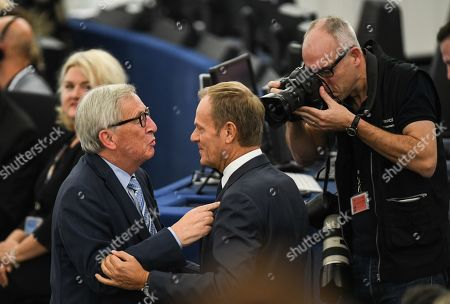 Jean-Claude Juncker (L), President of the European Commission, talks with European Council President Donald Tusk (R) during a debate on the last EU summit and Brexit at the European Parliament in Strasbourg, France, 22 October 2019.