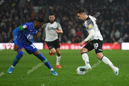 Tom Lawrence of Derby County takes on Dujon Sterling of Wigan Athletic