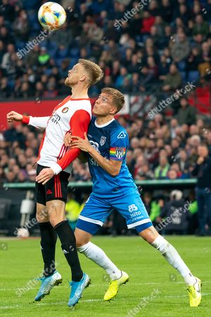 Nicolai Jorgensen (Feyenoord) duels Robin Propper (Heracles Almelo)