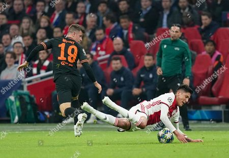 Edson Alvarez of Ajax falls following a challenge by Mason Mount of Chelsea