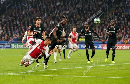 Tammy Abraham of Chelsea attempts to block a diving header from Edson Alvarez of Ajax