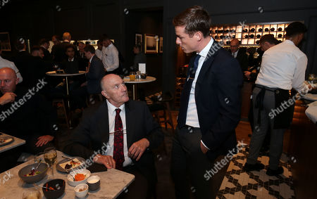 Stock Picture of George Cohen MBE (1966 World Cup Winner) celebrates his 80th birthday with a cake at Fulham - with Fulham Manager Scott Parker