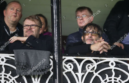 Ian Broudie (Lightning Seeds) (R)  watches from the Cottage
