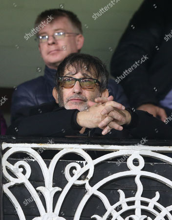 Stock Image of Ian Broudie (Lightning Seeds) watches from the Cottage