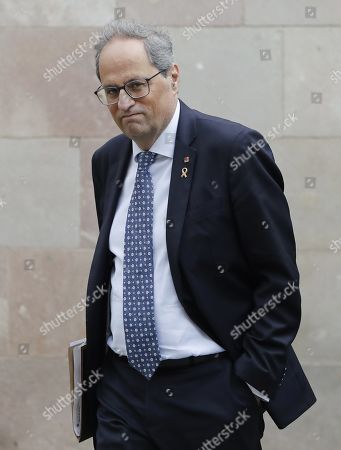 Stock Picture of Catalan regional President Quim Torra arrives to attend the weekly regional cabinet meeting in Barcelona, Spain, 22 October 2019. The cabinet meeting is the first one after a week of clashes between police and protesters against the Supreme's court sentence against Catalan leaders condemned for sedition and embezzlement. Catalonia region in Spain witnessed massive demonstrations and riots since the Spanish Supreme Court's 13 October ruling of prison terms against the Catalan political leaders accused of organizing the Catalan illegal referendum held in October 2017.
