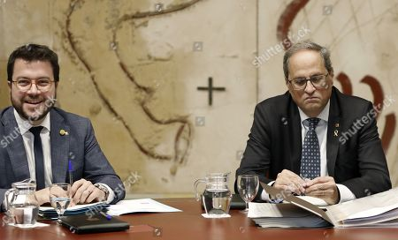 Stock Photo of Catalan regional President Quim Torra (R) and Catalan Vice President Pere Aragones (L) attend the weekly regional cabinet meeting in Barcelona, Spain, 22 October 2019. The cabinet meeting is the first one after a week of clashes between police and protesters against the Supreme's court sentence against Catalan leaders condemned for sedition and embezzlement. Catalonia region in Spain witnessed massive demonstrations and riots since the Spanish Supreme Court's 13 October ruling of prison terms against the Catalan political leaders accused of organizing the Catalan illegal referendum held in October 2017.
