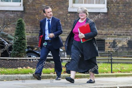 Secretary of State for Wales Alun Cairns (L) and Secretary of State for Work and Pensions, Minister for Women And Equalities Therese Coffey (R) arriving in Downing Street to attend the weekly cabinet meeting.