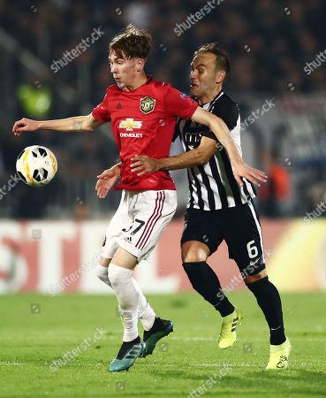 James Garner of Manchester United and Bibras Natkho of Partizan Belgrade.
