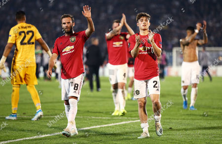 Daniel James and Juan Mata of Manchester United applaud the fans.