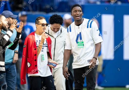 Stock Image of Indiana Pacers guard Victor Oladipo during pregame of NFL football game action between the Houston Texans and the Indianapolis Colts at Lucas Oil Stadium in Indianapolis, Indiana. Indianapolis defeated Houston 30-23