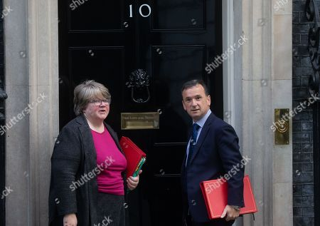 Alun Cairns and Therese Coffey arrive at Downing Street for the Cabinet meeting.