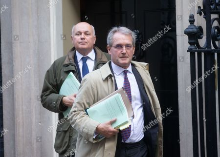 Owen Paterson and Iain Duncan Smith leave Downing Street after the Cabinet meeting.