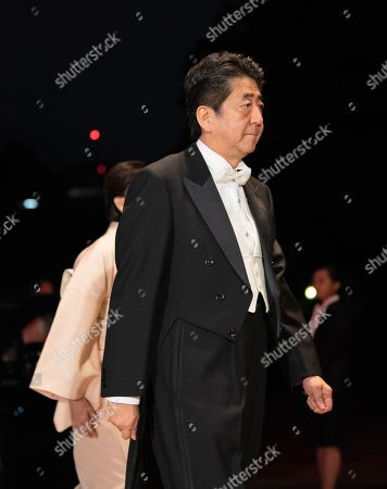 Japan's Prime Minister Shinzo Abe (C) and his wife Akie (behind, partially hidden) arrive at the Imperial Palace for the Court Banquets after the Ceremony of the Enthronement of Emperor Naruhito in Tokyo, Japan, 22 October 2019. Some 400 guests from Japan and international head of states were reported to attend the 'Kyoen-no-gi' banquet.