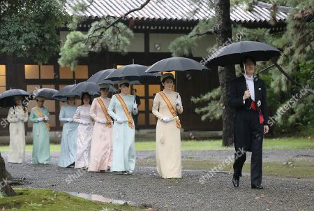 Japanese Crown Prince Akishino (R) and Crown Princess Kiko (2-R) walk to attend the Sokuirei-Tojitsu-Kashikodokoro-Omae-no-gi Ceremony at the Imperial Palace ahead of Emperor Naruhito's enthronement ceremony, in Tokyo, Japan, 22 October 2019. Some 2,000 guests from Japan and dignitaries from over 180 countries are expected to attend the enthronement ceremony.