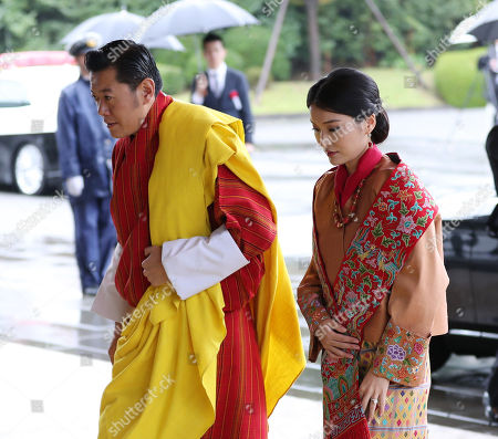 Druk Gyalpo of Bhutan Jigme Khesar Namgyel Wangchuck (L) and his wife, Jetsun Pema (R), arrive at the Imperial Palace to attend the enthronement ceremony of Japan's Emperor Naruhito, in Tokyo, Japan, 22 October 2019. Some 2,000 guests from Japan and dignitaries from over 180 countries are expected to attend the enthronement ceremony.