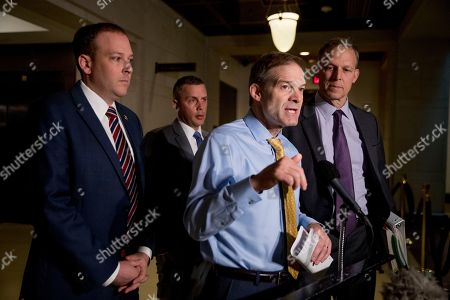 Stock Image of Kelly Armstrong, Lee Zeldin, Jim Jordan, Scott Perry. Republican lawmakers, from left, Rep. Lee Zeldin R-N.Y., Rep. Kelly Armstrong R-N.D., Rep. Jim Jordan, R-Ohio, ranking member of the Committee on Oversight Reform, and Rep. Scott Perry, R-Pa., speak to members of the media before former U.S. Ambassador William Taylor arrives for a closed door meeting to testify as part of the House impeachment inquiry into President Donald Trump, on Capitol Hill in Washington