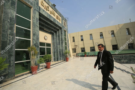 Stock Photo of Qamar Nadeem laywer of Shakil Afridi, accused of running a fake vaccination campaign to get DNA of Al-Qaeda chief Osama bin Laden on behalf of the United States Central Intelligence Agency (CIA), leaves after a hearing, where the court adjourned the case into Afridi's case in Peshawar, Pakistan, 22 October 2019. A Pakistani court in August 2013 had overturned the 33-year jail sentence and ordered a retrial of the doctor who allegedly helped the CIA hunt down al-Qaeda leader Osama bin Laden. Shakil Afridi was sentenced in May 2012 by the Kyber tribal district court for having links with a banned militant outfit. He challenged the punishment in a Peshawar court.