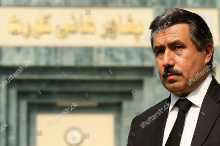 Qamar Nadeem laywer of Shakil Afridi, accused of running a fake vaccination campaign to get DNA of Al-Qaeda chief Osama bin Laden on behalf of the United States Central Intelligence Agency (CIA), leaves after a hearing, where the court adjourned the case into Afridi's case in Peshawar, Pakistan, 22 October 2019. A Pakistani court in August 2013 had overturned the 33-year jail sentence and ordered a retrial of the doctor who allegedly helped the CIA hunt down al-Qaeda leader Osama bin Laden. Shakil Afridi was sentenced in May 2012 by the Kyber tribal district court for having links with a banned militant outfit. He challenged the punishment in a Peshawar court.