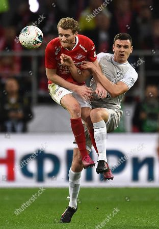 Stock Photo of Rubin's Filip Uremovic (right) and Spartak's Andre Schurrle (left) during the match.