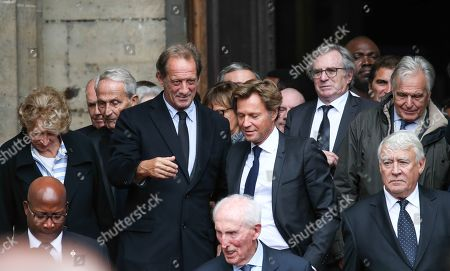 French actor Vincent Lindon (L) and journalist Laurent Delahousse leave at the Saint-Sulpice church
