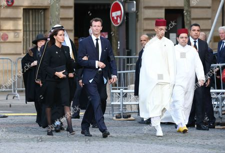 Morocco's Prince Moulay el-Hassan and Prince Joachim of Denmark arrive at the Saint-Sulpice church