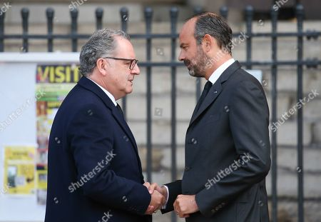 French Prime Minister Edouard Philippe discusses shaking hands with President of French National Assembly Richard Ferrand at the Saint-Sulpice church