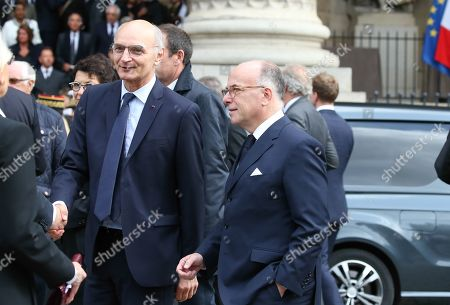 Chairman of the Court of Auditors (Cour des Comptes) Didier Migaud and French former Prime Minister Bernard Cazeneuve (C) leave at the Saint-Sulpice church