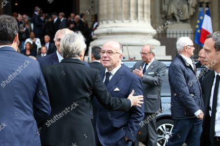 French former Prime Minister Bernard Cazeneuve discusses as he leaves at the Saint-Sulpice church