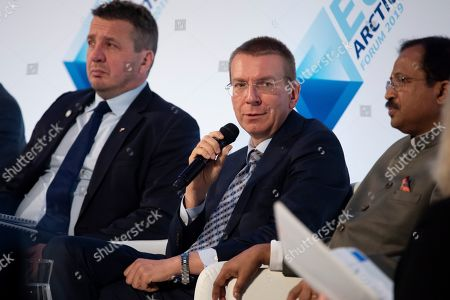 Foreign Minister of Latvia Edgars Rinkevics speaks while Foreign Minister of Iceland Gudlaugur Tho´r Tho´rdarson (L) and Indian Minister of State for Parliamentary Affairs V. Muraleedharan (R) listen