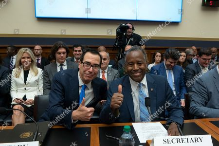 United States Secretary of the Treasury Steven Mnuchin and United States Secretary of Housing and Urban Development (HUD) Ben Carson pose for a photo prior to the U.S. House Committee on Financial Services hearing on Capitol Hill