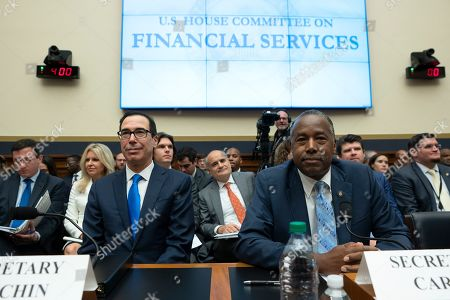 United States Secretary of the Treasury Steven Mnuchin and United States Secretary of Housing and Urban Development (HUD) Ben Carson wait to testify before the U.S. House Committee on Financial Services on Capitol Hill