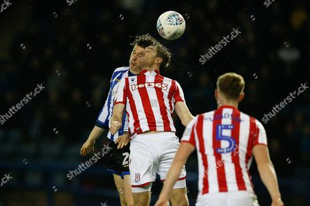 Adam Reach of Sheffield Wednesday and Stephen Ward of Stoke City compete for the ball during the EFL Sky Bet Championship match between Sheffield Wednesday and Stoke City at Hillsborough, Sheffield