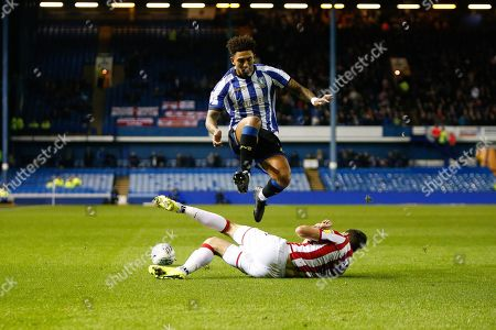 Stephen Ward of Stoke City slide challenges Liam Palmer of Sheffield Wednesday during the EFL Sky Bet Championship match between Sheffield Wednesday and Stoke City at Hillsborough, Sheffield
