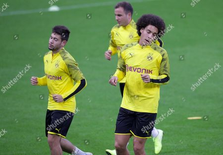 Borussia Dortmund's mildfielder Axel Witsel (R) and defender Raphael Guerrero (L) during a training session on the eve of the UEFA Champions League group F soccer match FC Inter vs Borussia  Dortmund at the  Giuseppe Meazza Stadium in Milan, Italy, 22, October 2019.